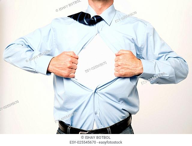 Cropped image of an executive tearing his shirt