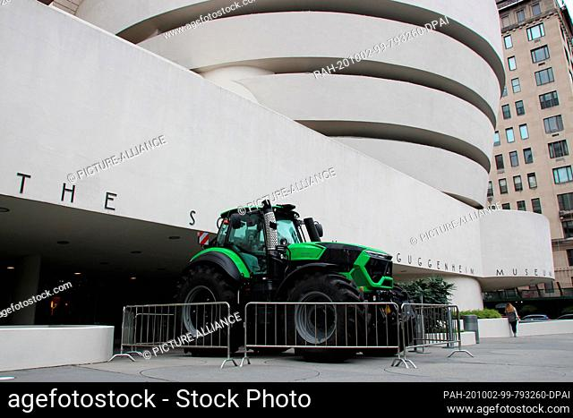 """30 September 2020, US, New York: In front of the rotunda of the Guggenheim Museum, a tractor can be seen that is part of the show """"""""Countryside"""