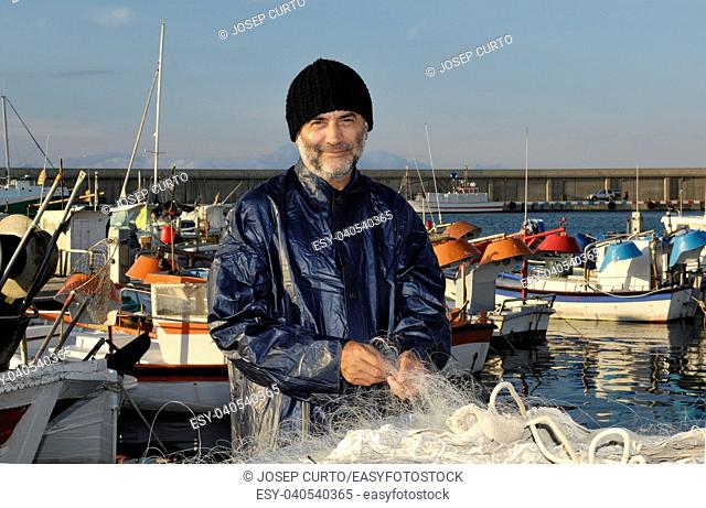 fisherman working in the fishing port, L'Escala, Costa Brava, Girona province, Spain