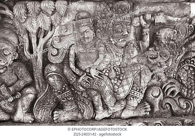 Singaraja temple, the Demi Gods in the forest on the facet of the entrance to the temple. Bali Indonesia