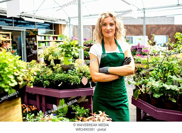 Female florist standing with arms crossed
