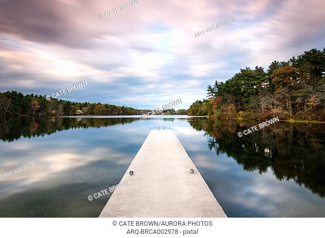 Beautiful scenery with jetty on lake under overcast sky, Massachusetts, USA