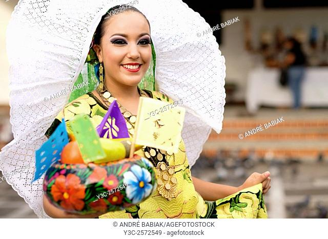 Mexican woman portrait with fruit bowl. Puerto Vallarta, Jalisco, Mexico. Xiutla Dancers - a folkloristic Mexican dance group in traditional costumes...
