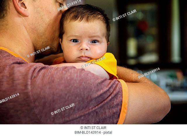 Caucasian father holding baby boy
