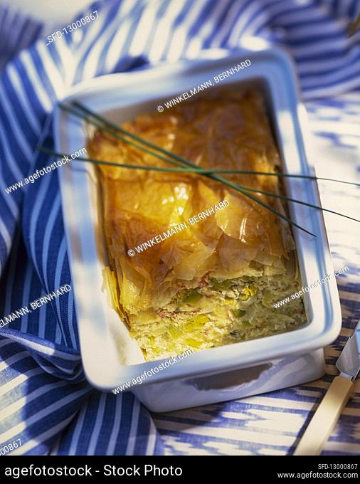 Leek terrine with a filo pastry topping and chives