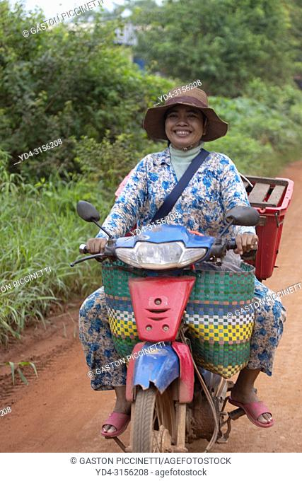 Woman in the motorcycle, Siem reap Province, Kingdon of Cambodia