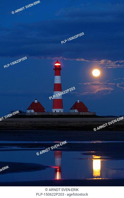 Lighthouse Westerheversand at night with full moon at Westerhever, Wadden Sea National Park, North Frisia, Schleswig-Holstein, Germany