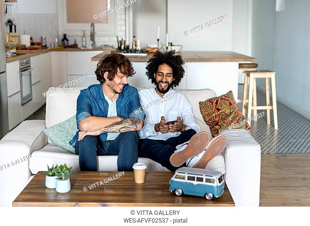 Friends sitting on couch, planning road trip