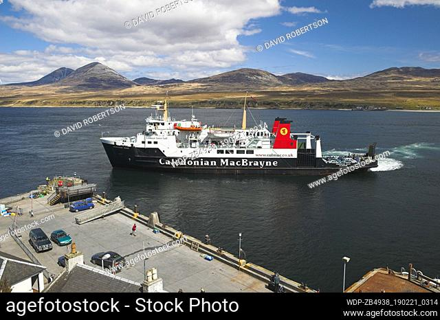 Caledonian MacBrayne ferry arriving at Port Askaig, Isle of Islay, Argyll and Bute, Scotland. The Paps of Jura are the backdrop