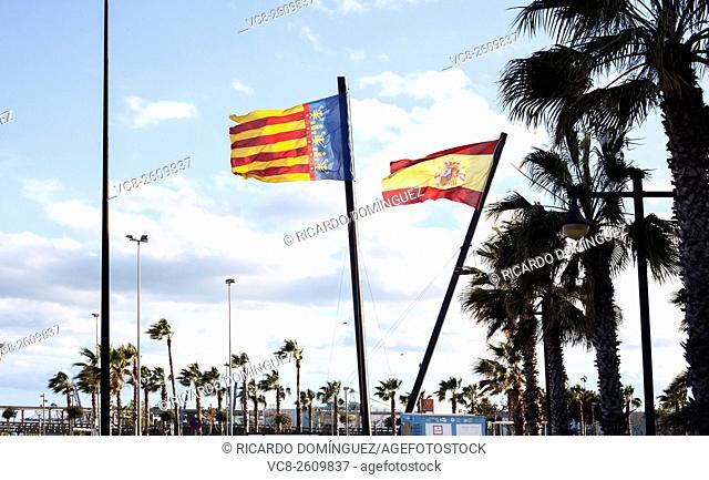 Huge flags of Valencian Community (Pais Valencià) and Spain in Marina Real Juan Carlos I. Valencia, Spain