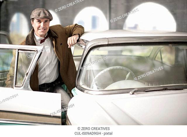 Man getting into vintage car