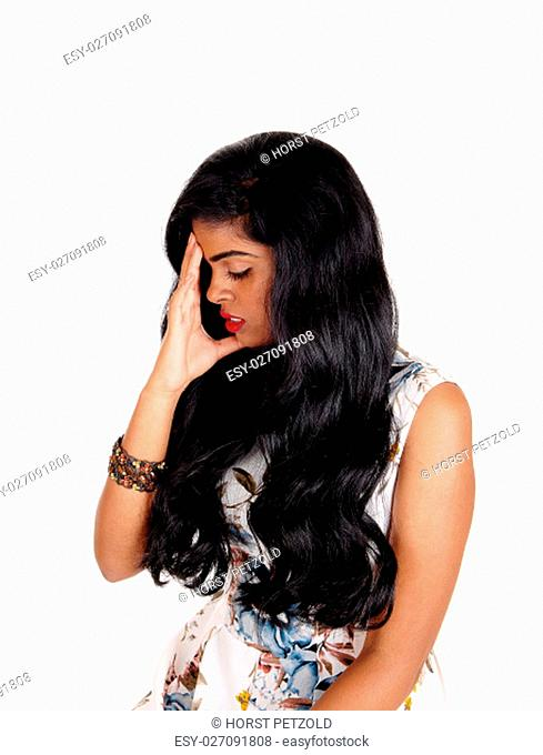 An beautiful woman with long black hair standing and holding her.head for a headache, isolated for white background.