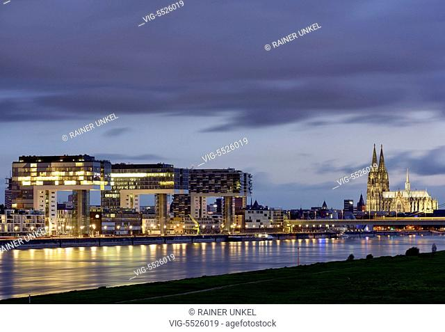 DEU , GERMANY : Crane houses in the port of Cologne at Rhine river and Cologne Cathedral , 08.08.2016 - Cologne, Northrhine-Westfalia, Germany, 08/08/2016