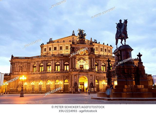 opera house Semperoper and Statue Of King Johann on Theater square in Dresden at night, Saxony, Germany, Europe