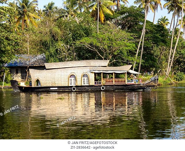 backwater with houseboat at alleppey, kerala, india