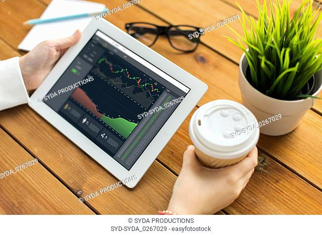 hands with cryptocurrency on tablet pc screen