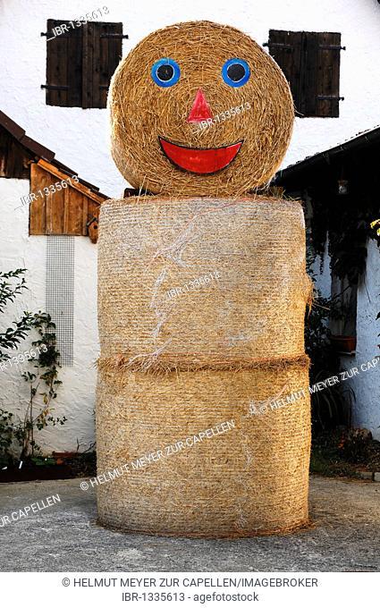 Straw bales decorated as a man on a farm, Haidhof, Upper Franconia, Bavaria, Germany, Europe