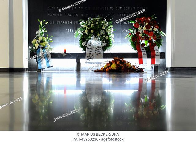 Wreaths are in display on front of a memoiral plate dedicated to the victims of nationalsocialism in Cologne, Germany, 9 NOvember 2013