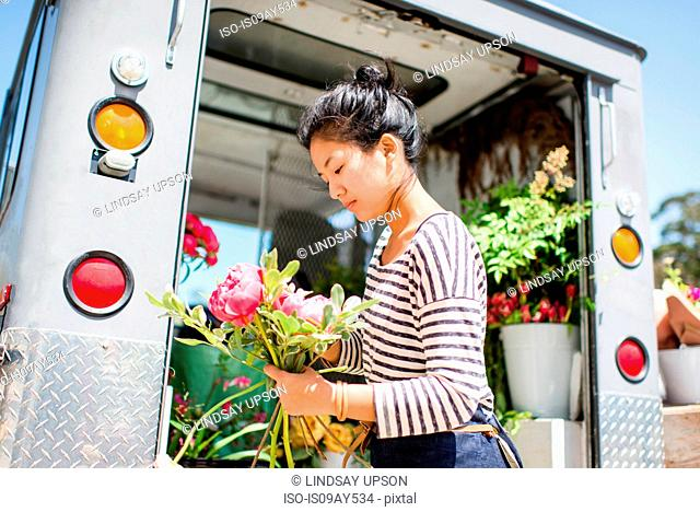 Florist with bunch of flowers in hand