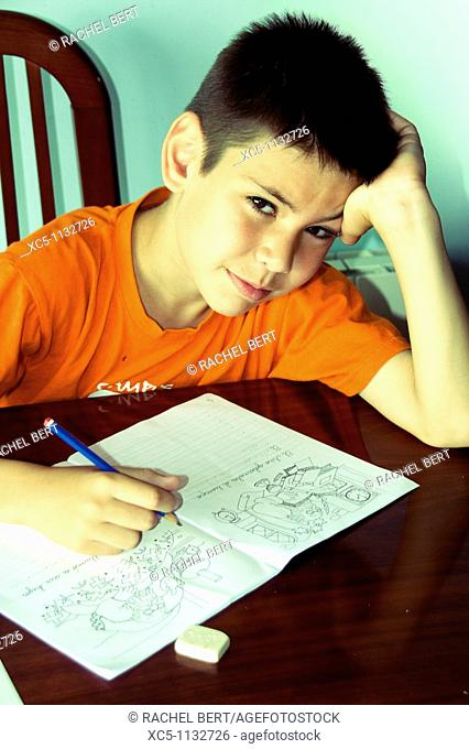 9 years old boy doing homework