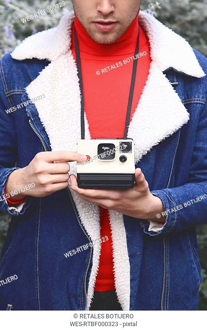 Man taking instant photography outdoors