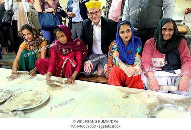 German Development Minister Gerd Mueller visits the great kitchen at the Gurudwara Sis Ganj Sahib Sikh tempel during a tour of New Dehli, India