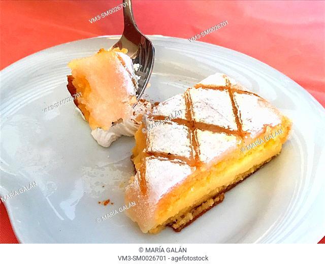 Eating Ponche segoviano, traditional dessert. Segovia, Spain