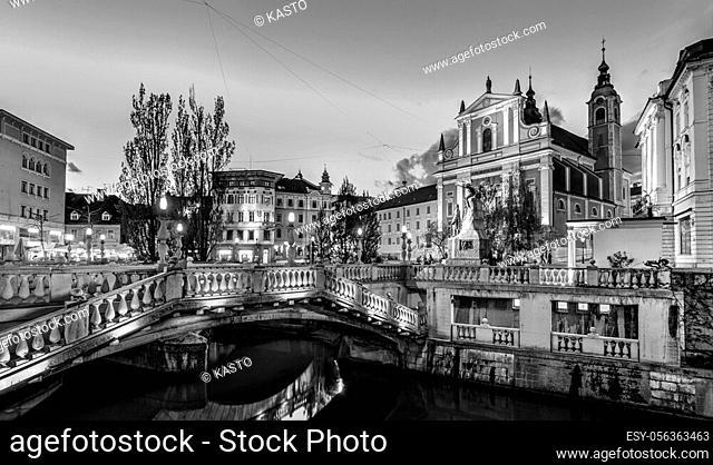 Romantic Ljubljana's city center in black and white: river Ljubljanica, Triple Bridge - Tromostovje, Preseren square and Franciscan Church of the Annunciation