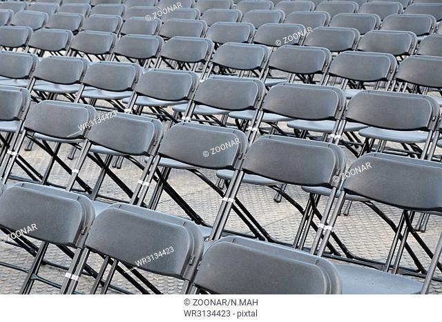 many empty black folding chair rows