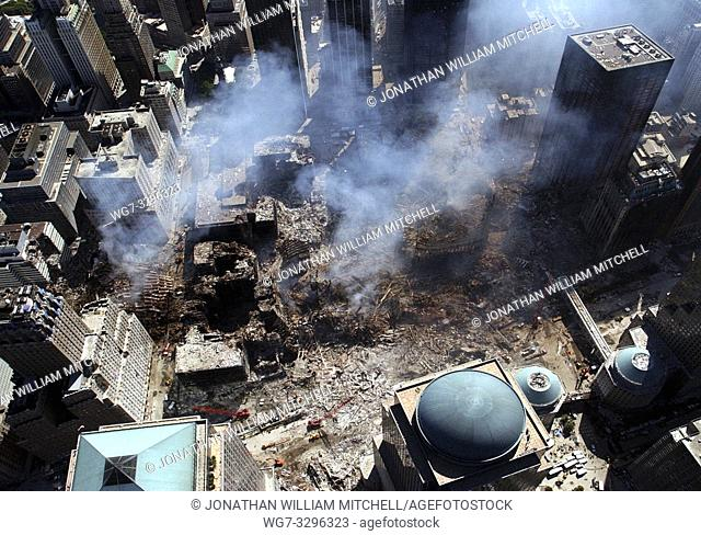 USA New York -- 17 Sep 2001 -- Rescue workers conduct search and rescue attempts, descending deep into the rubble at 'Ground Zero' at the World Trade Center in...