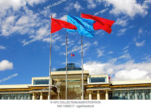 Flags in the Mongolian national colours red and blue in front of the Parliament building, Ulaanbaatar, Mongolia