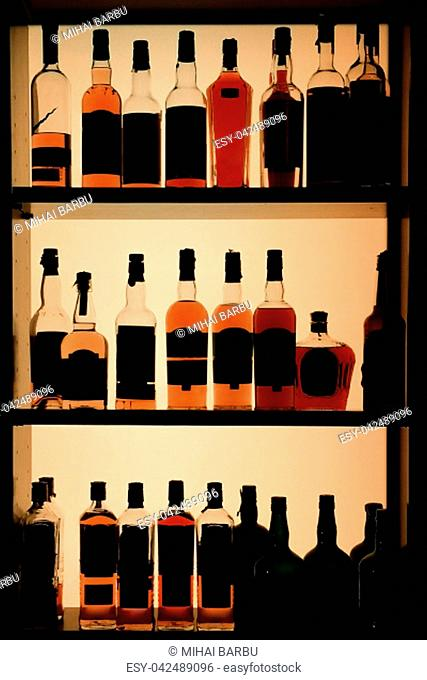 Various bottles of alcohol displayed in a pub