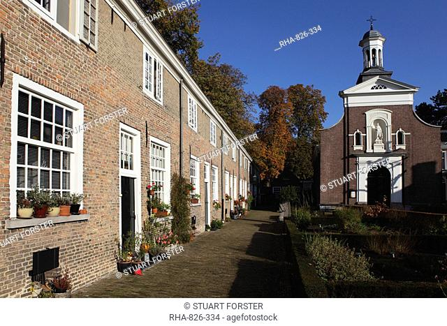 Chapel and brick housing within the courtyard of the Begijnhof Beguinage in Breda, Noord-Brabant, Netherlands, Europe