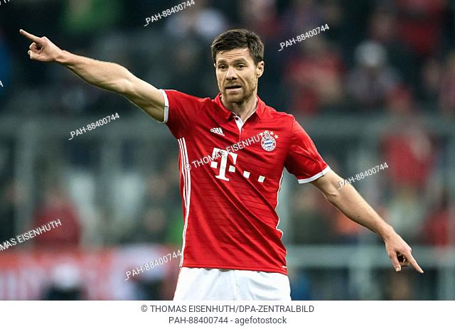 Munich's Xabi Alonso, photographed during the UEFA Champions League round of 32 soccer match between FCBayern Munich and FCArsenal London at the Allianz Arena...