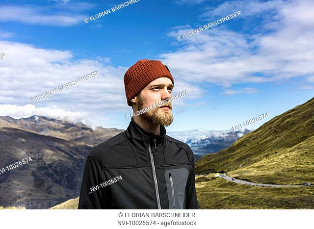 Portrait of a young man at the Crown Range Road, New Zealand