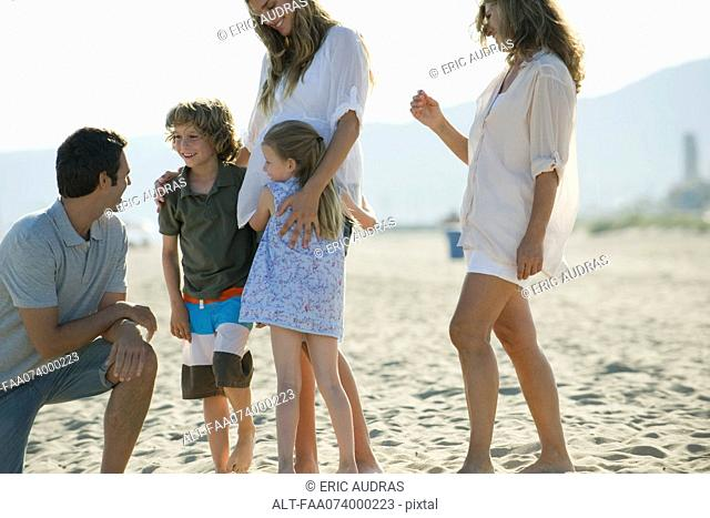 Family spending time together at the beach
