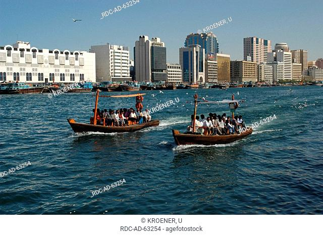 People on water taxis ferries between old town und Deira Skyline of Dubai United Arab Emirates