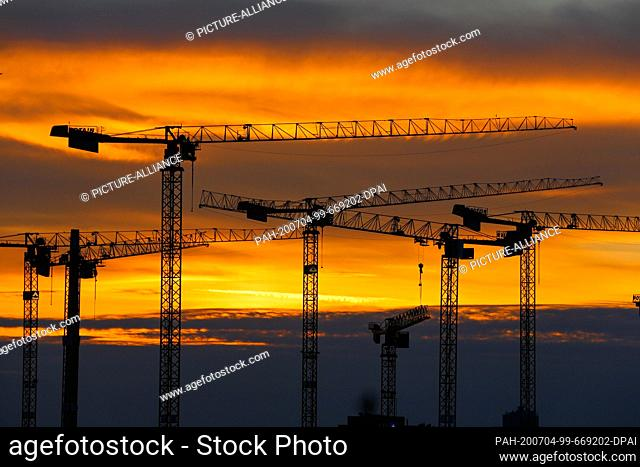 03 July 2020, Berlin: View from the Bode-Museum to the Berlin skyline with construction cranes at sunset. Photo: Gerald Matzka/dpa-Zentralbild/ZB