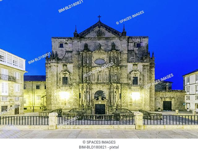 Ornate church illuminated at night, Santiago de Compostela, A Coruna, Spain