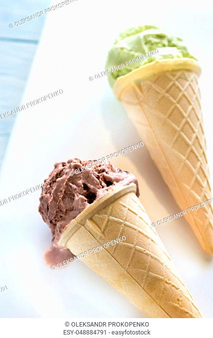 Two cones of nut-flavored ice cream on the white background