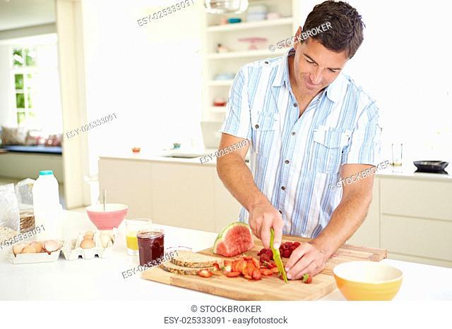 Man Preparing Healthy Breakfast In Kitchen