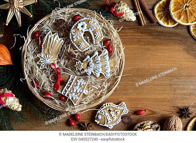 Christmas background with copy space: Christmas gingerbread cookies in a round wicker basket, top view