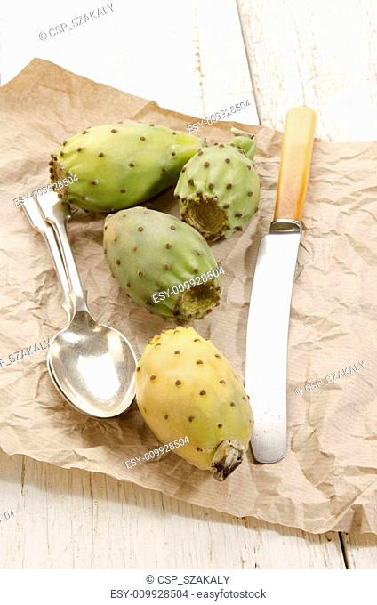 cactus fig with knife and spoon