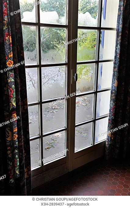 view through a patio window, Centre-Val-de-Loire region, France, Europe