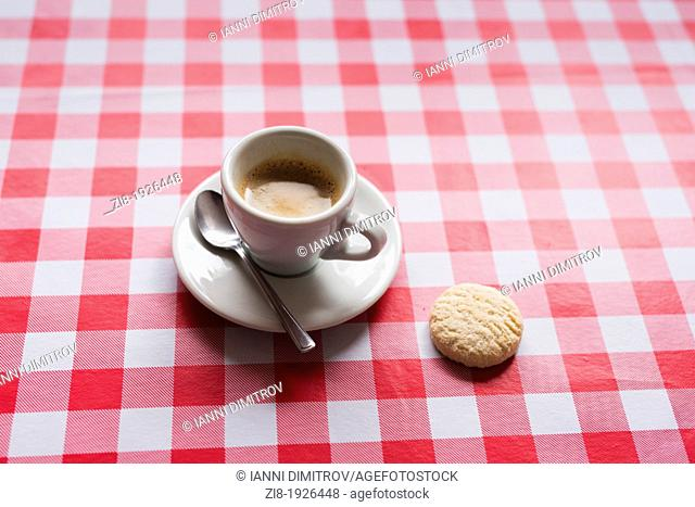 Cup of espresso and a biscuit