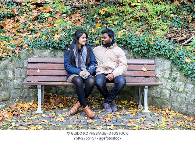 Aachen, Germany. Young Indian couple of university exchange students walking the Lousberg City Park during their weekend day of
