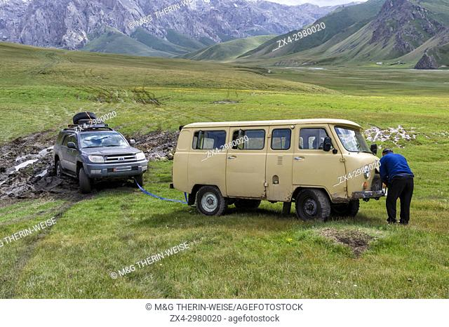 Pulling out a bogged down car, Kurumduk valley, Naryn province, Kyrgyzstan, Central Asia