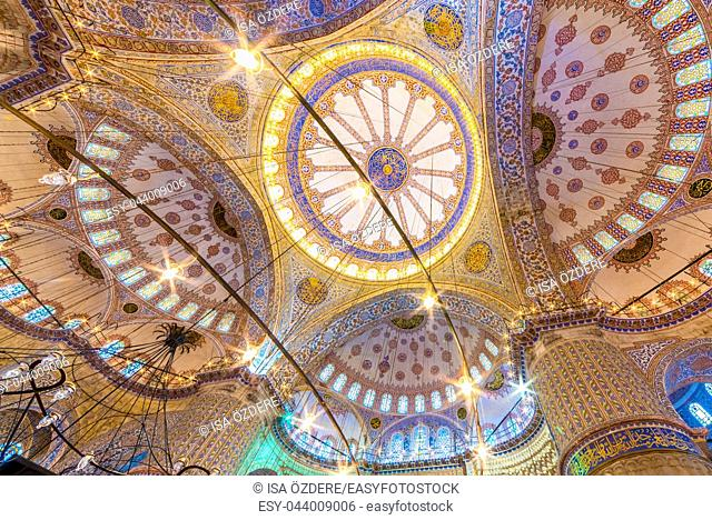 Interior decoration view and artworks of Blue Mosque also called Sultan Ahmed Mosque. Ceiling and domes decorations. ISTANBUL,TURKEY- MARCH 11, 2017