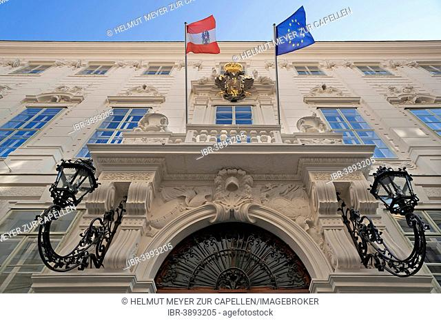 Former city palace of Prince Eugene, built 1697 - 1698, with the flags of Austria and Europe flanking the arms of the Teutonic Knights on the Austrian...