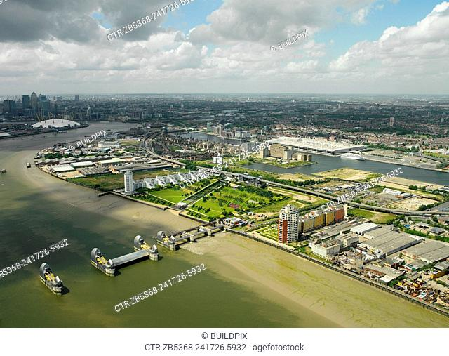 Aerial view of the Thames Barrier, ExCel Exhibition Centre on Royal Victoria Dock, Barrier Point, a landmark prestige housing development by Barratt